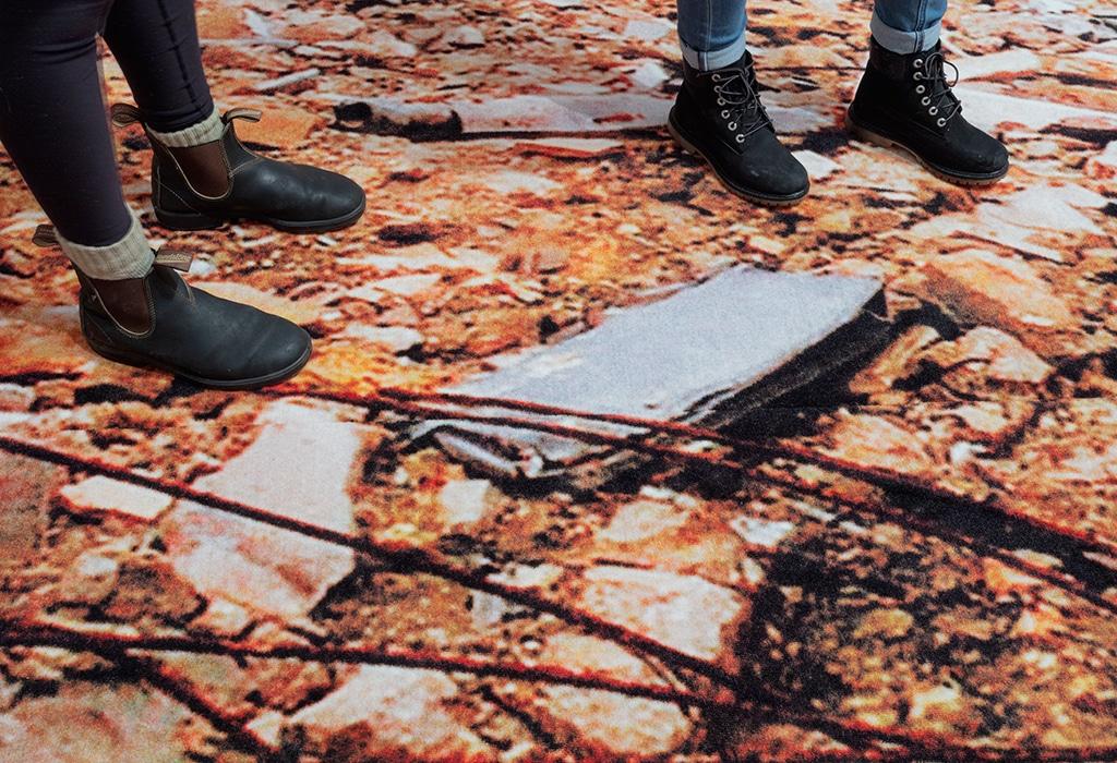 walking on carpet, two pairs of feet
