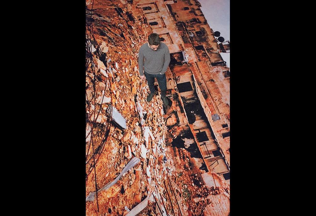 man standing on printed carpet